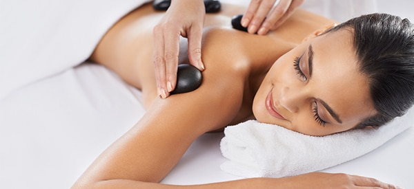 Downtown Denver | Customized massage with hot stones.