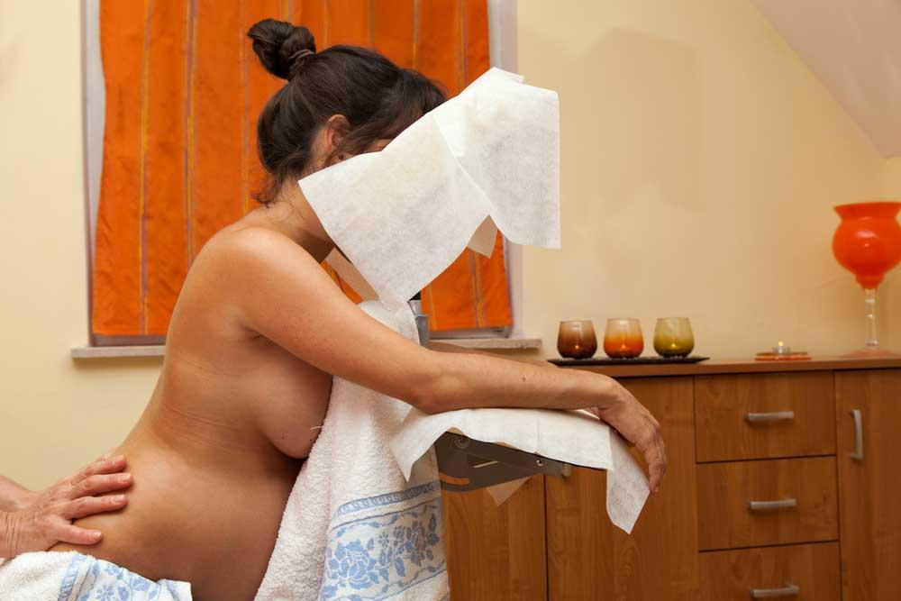Pregnant Woman at Prenatal Massage session