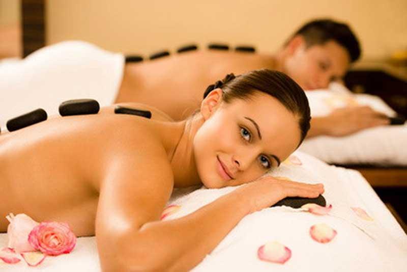 Couple's Receiving hot stone massage